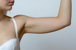 Woman showing upper arm
