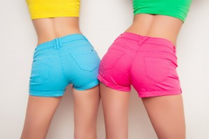 Two woman in bright coloured shorts